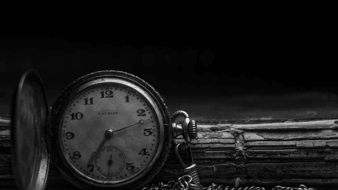 grayscale photography of silver watch
