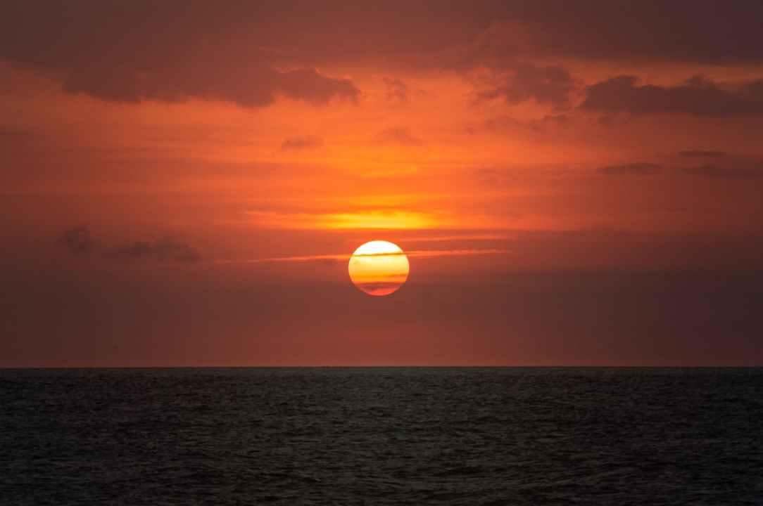 afterglow beach clouds dark