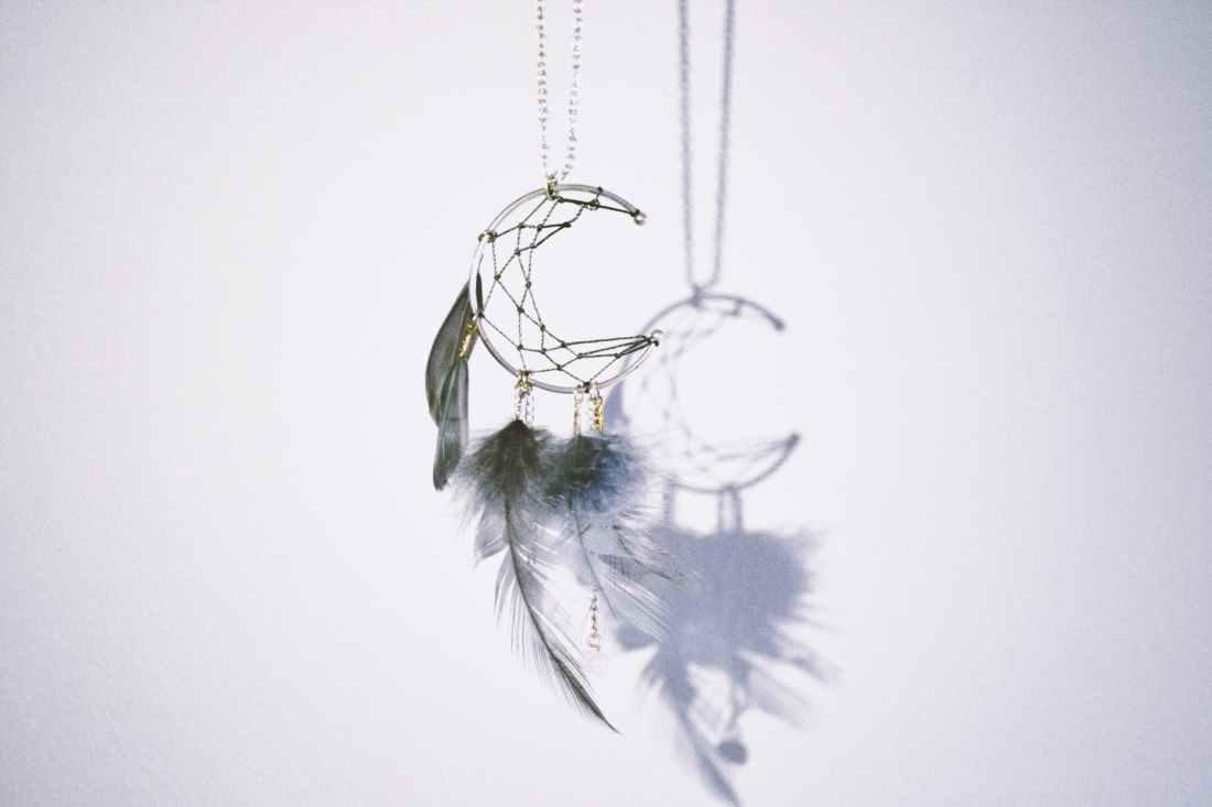 silver colored crescent moon pendant