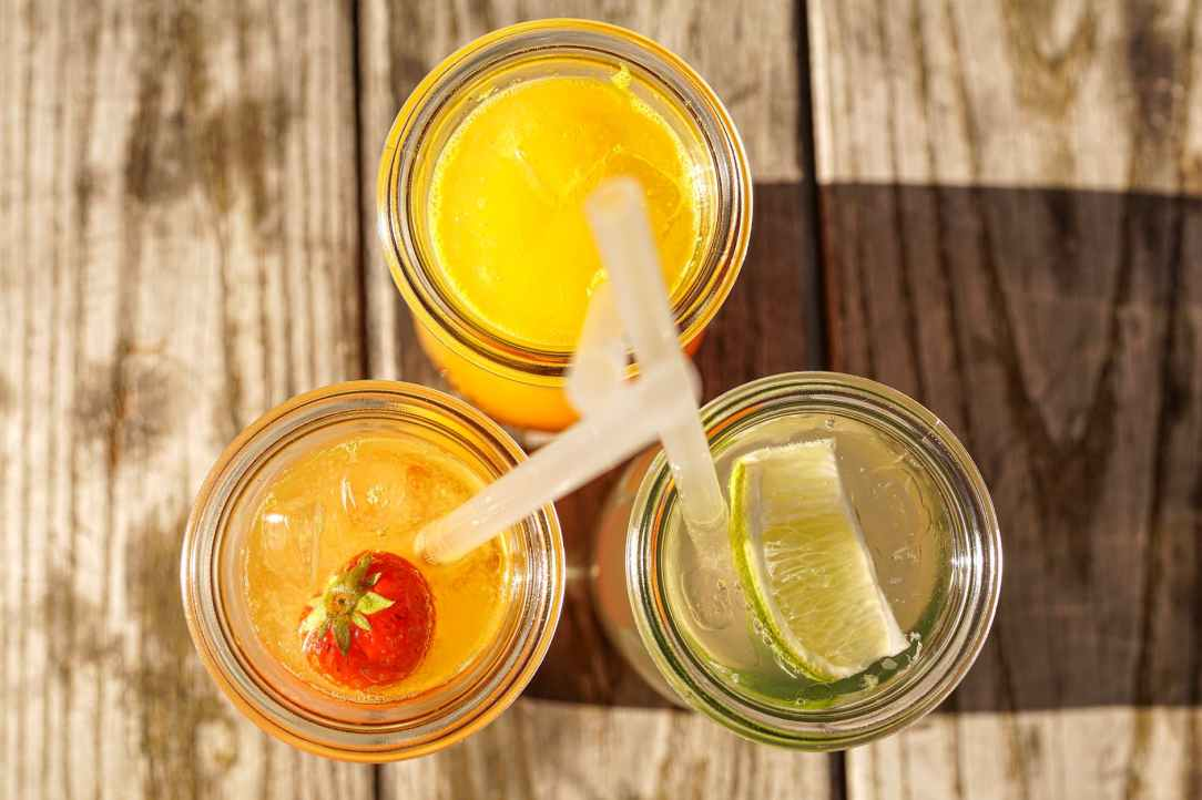 assorted juice on glass bottles