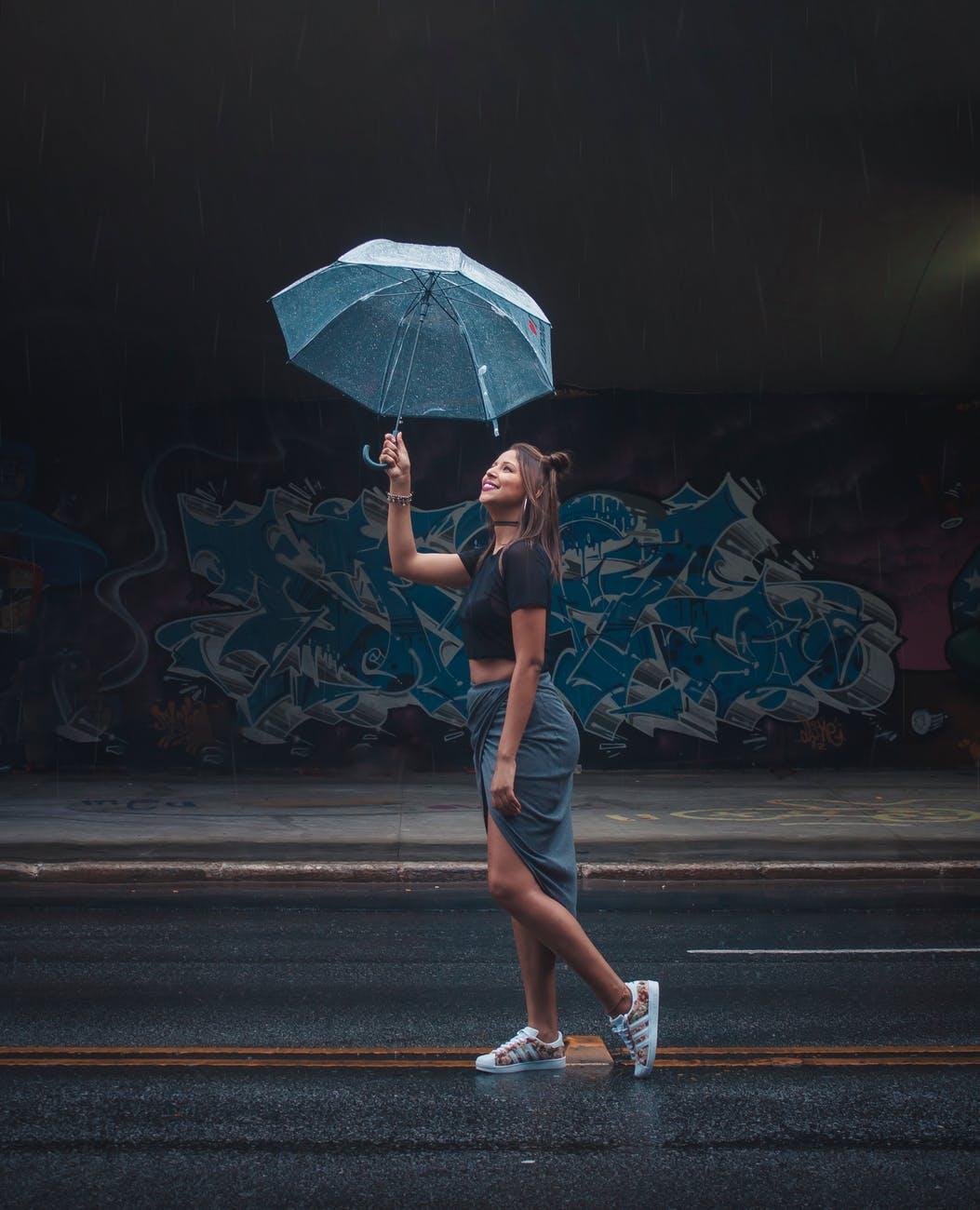 woman holding transparent umbrella