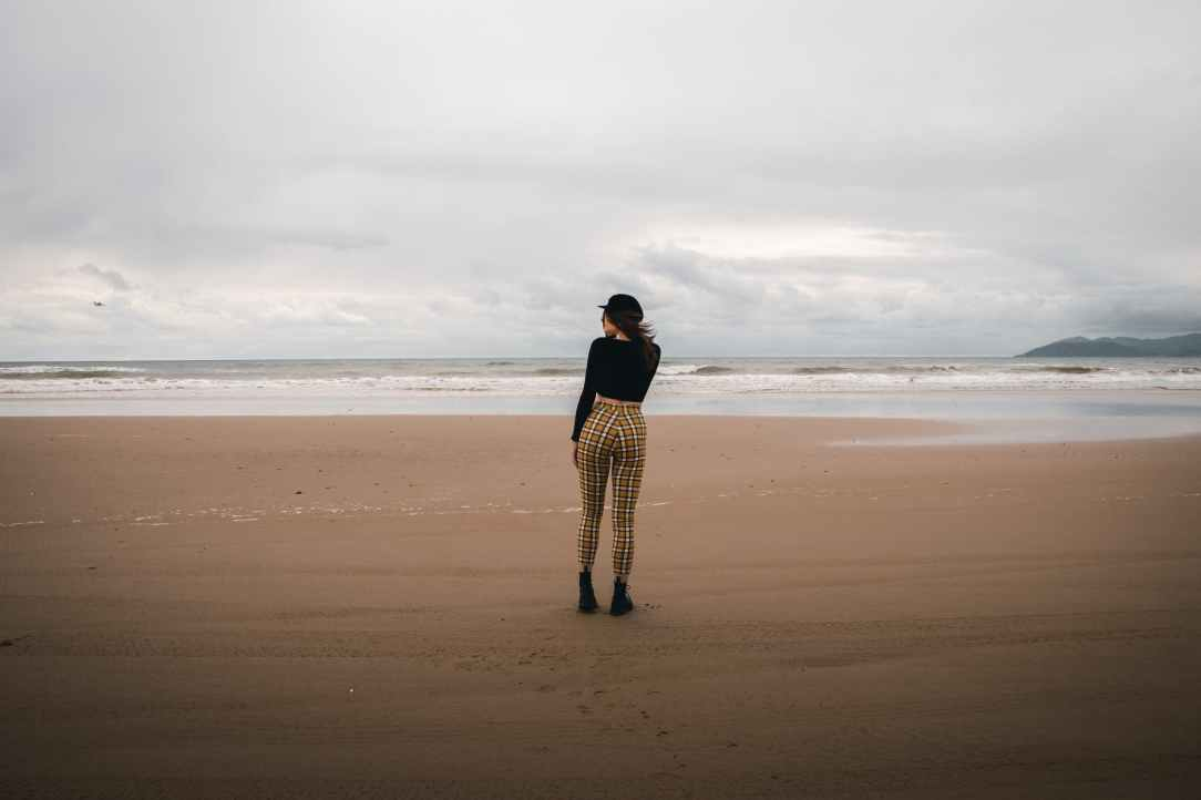 woman standing on shoreline