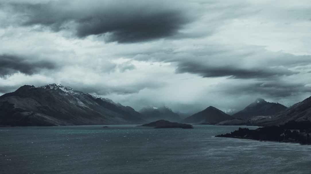 beach black and white clouds dawn