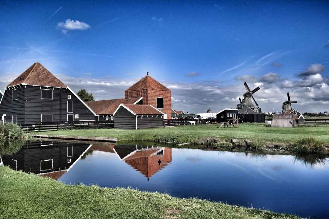 brown grey barn house near windmill during daytime
